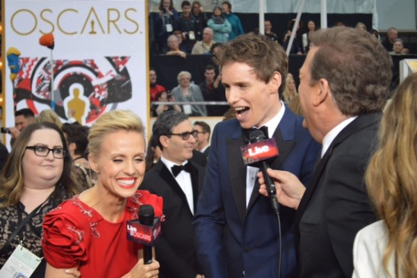 Oscars 2015 and Eddie Redmayne and Jessica Holmes and Sam Rubin and KTLA TV Anchor & TV Host